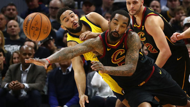 R Smith #5 of the Cleveland Cavaliers and Cory Joseph #6 of the Indiana Pacers drive for a ball during the first half in Game One of the Eastern Conference Quarterfinals during the 2018 NBA Playoffs.