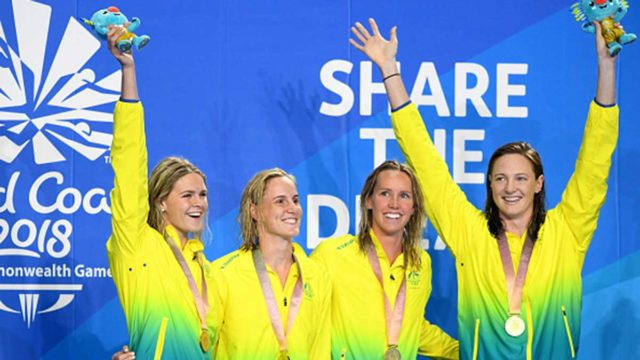 Australian female 4x100m Freestyle Relay team receive their medals on day one of the Commonwealth Games.