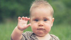 Baby waving, Getty