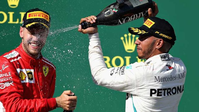 Hungary GP winner Lewis Hamilton sprays runner-up Sebastian Vettel on the podium in Budapest last night. Pic: Getty