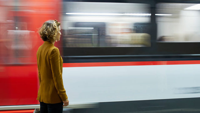 A woman who's missed her train stares as it passes by. Pic: Getty