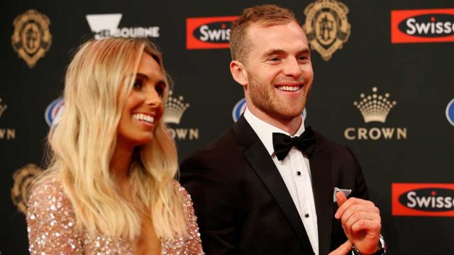 Hannah Davis and 2018 AFL Brownlow Medal winner Tom Mitchell hit the red carpet last night. Pic: Adam Trafford