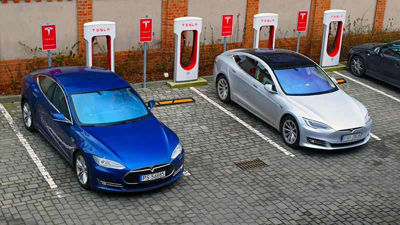 Tesla Model S vehicles on a electric charging point. Source: Getty.