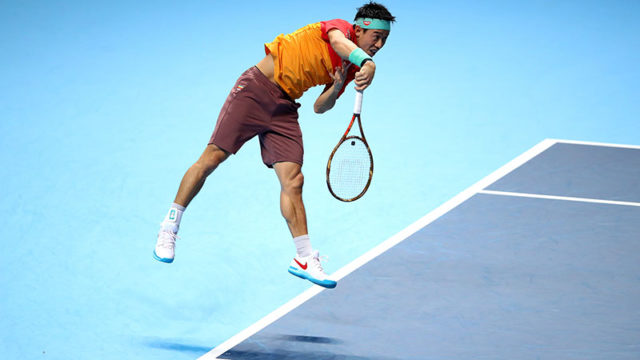 Kei Nishikori of Japan leaps in the air while serving in an ATP World Tour Finals match in London overnight. Pic: Getty