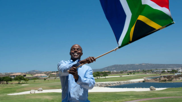 Man Waving a South African Flag